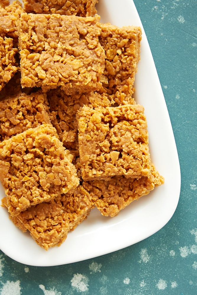 Peanut Butter Corn Flake Bars stacked on a white tray