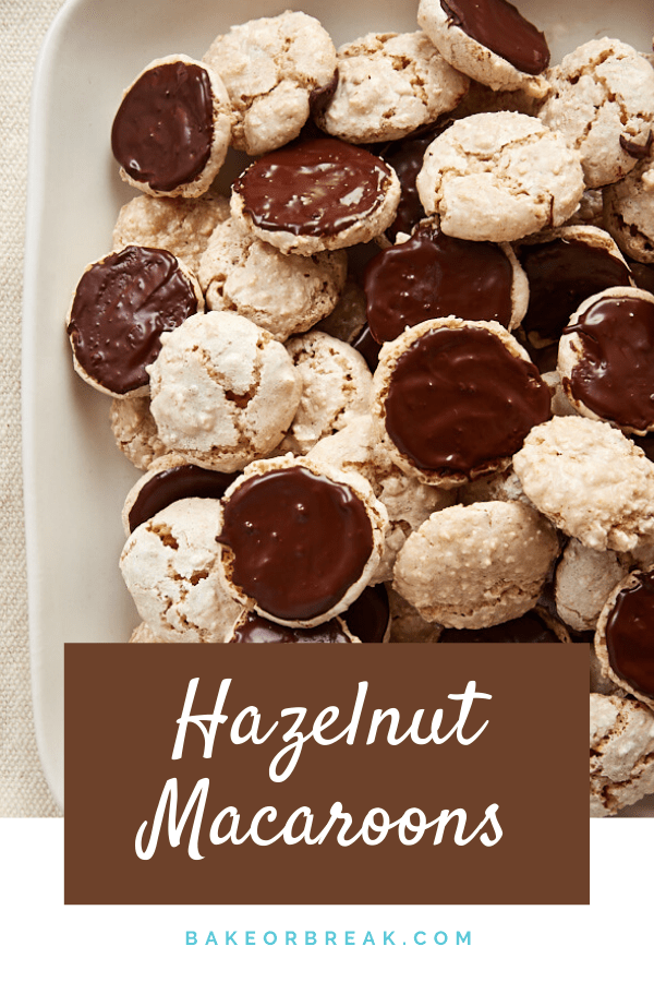 Hazelnut Macaroons are sweet, simple, nutty cookies. Dress them up with some dark chocolate for a beautiful and irresistible treat! - Bake or Break #macaroons #cookies #hazelnuts