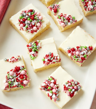 Peppermint Sugar Cookie Bars topped with holiday sprinkles