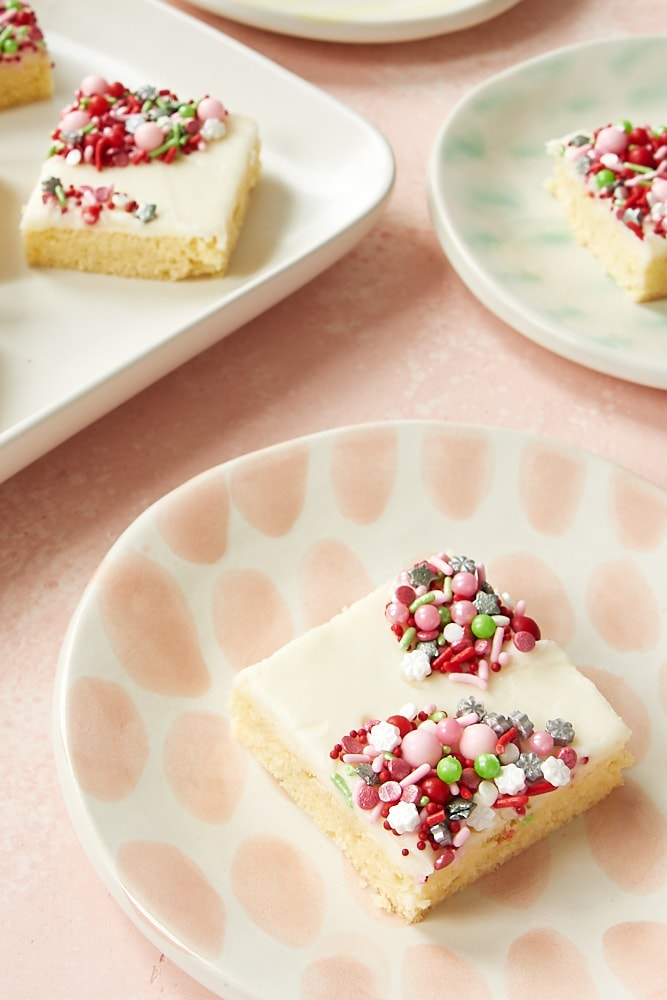 Peppermint Sugar Cookie Bars on colorful plates