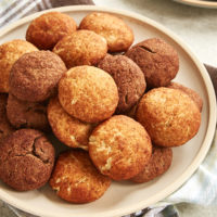 Snickerdoodles and Chocodoodles piled on a beige plate