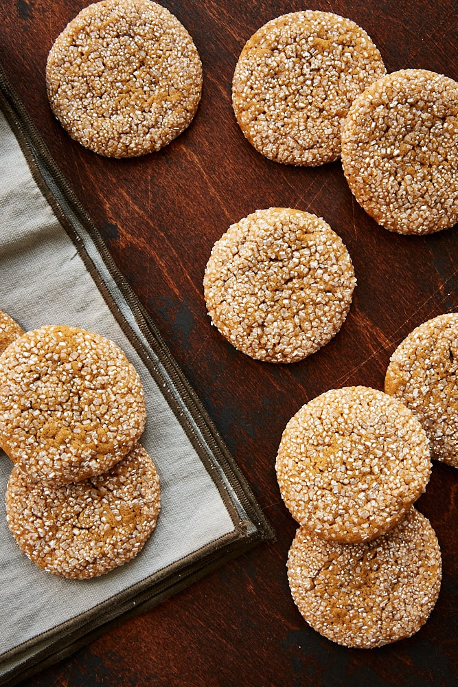 Soft Ginger Molasses Cookies on a dark wooden surface
