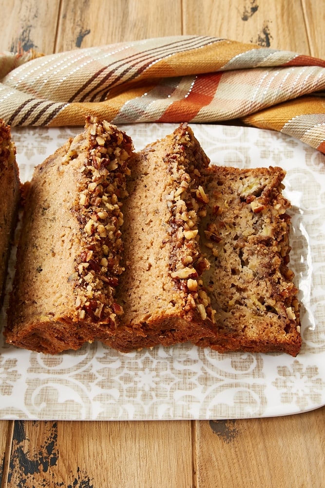slices of Brown Butter Banana Bread on a patterned tray