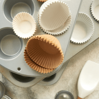 muffin pans, liners, scoops, and other tools for baking muffins