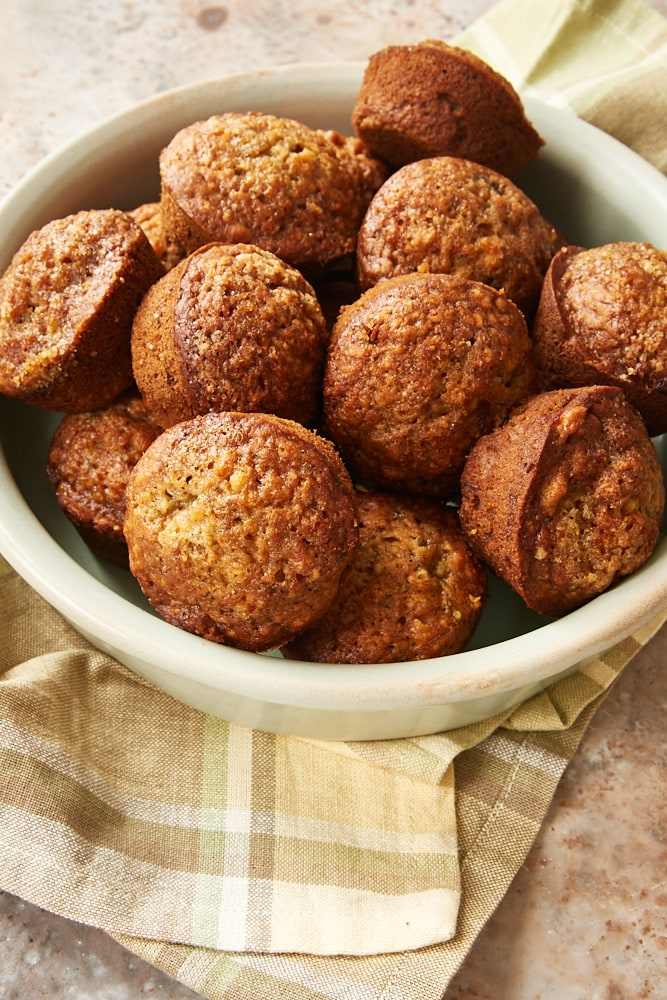 Cookie Butter Banana Muffins in a shallow green dish