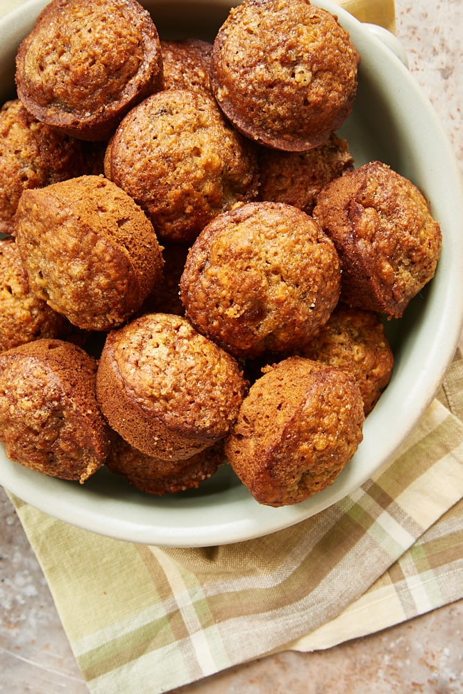 Cookie Butter Banana Muffins in a green stoneware dish