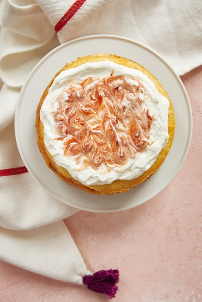 Vanilla Bean Cheesecake for Two topped with strawberry-swirled whipped cream