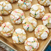 Sprinkle Crinkle Cookies on a parchment-lined baking sheet