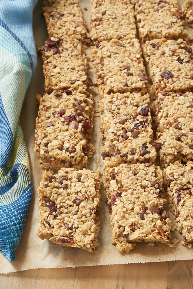 Cranberry Chocolate Chip Pecan Granola Bars on a sheet of parchment paper