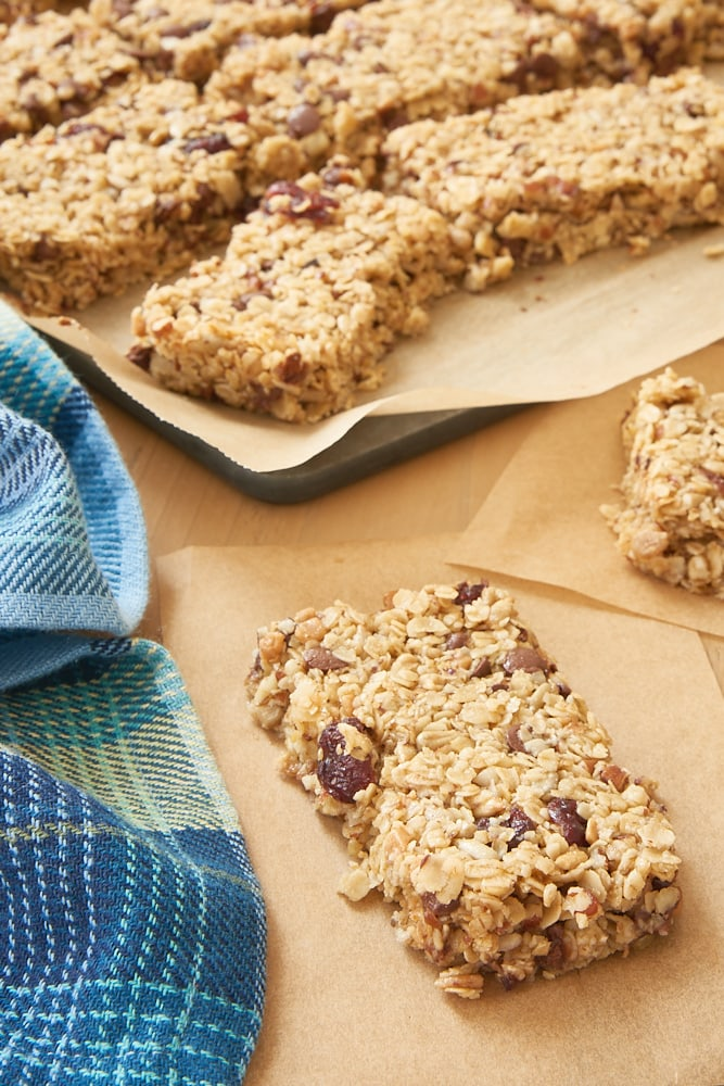 Cranberry Chocolate Chip Pecan Granola Bars on parchment paper