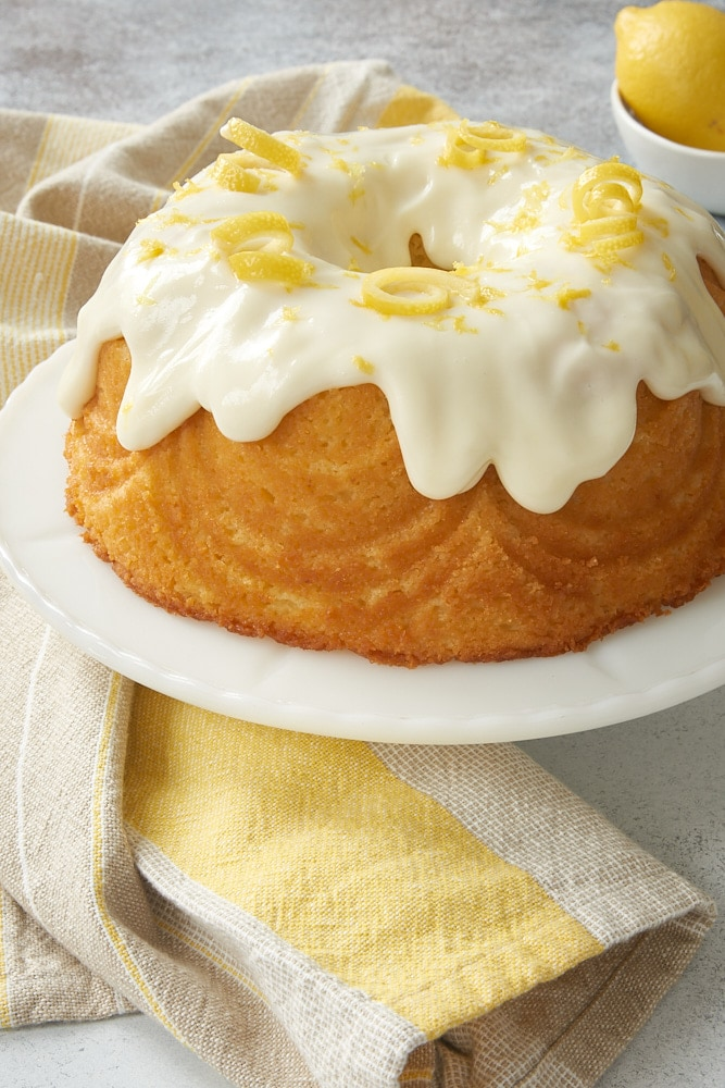 Lemon Bundt Cake on a white cake stand