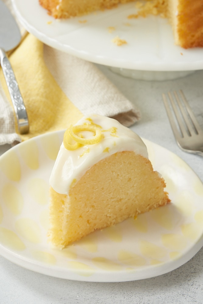 slice of Lemon Bundt Cake on a white and yellow plate