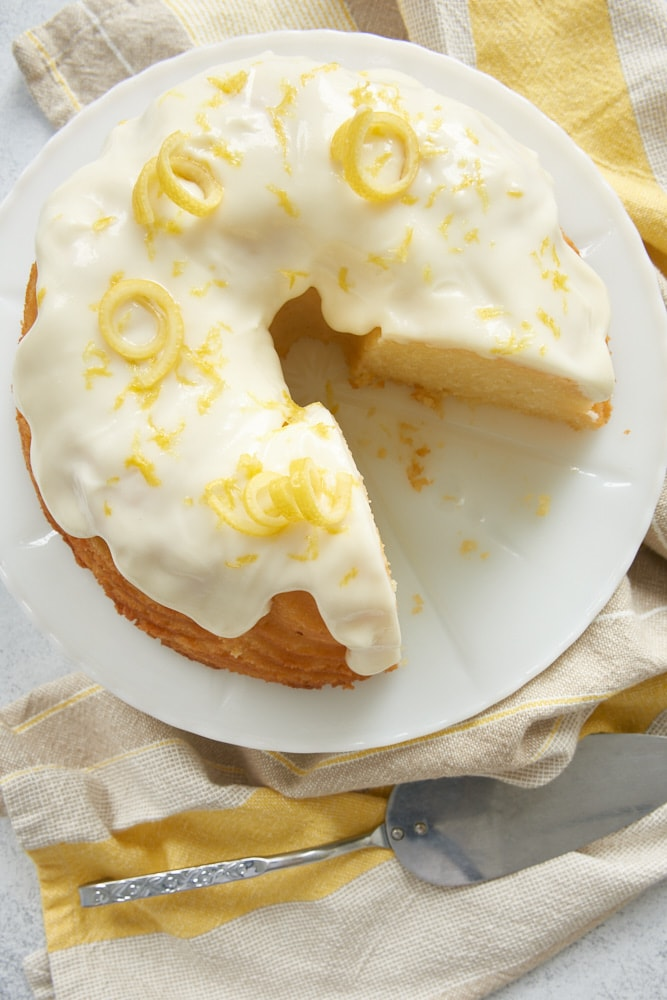 Lemon Bundt Cake topped with lemon curls and zest