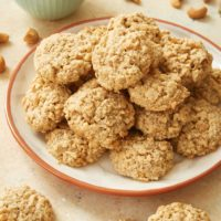 Salted Cashew Crunch Cookies on an orange-rimmed plate