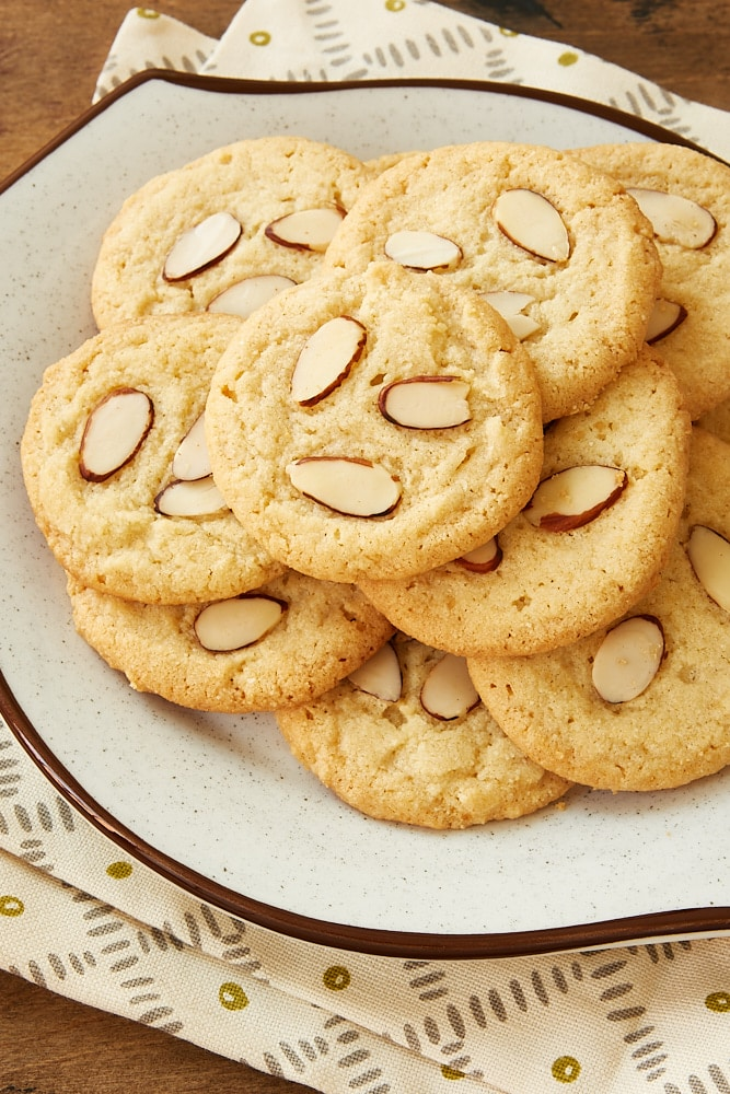 pile of Almond Cookies on a white and brown speckled plate