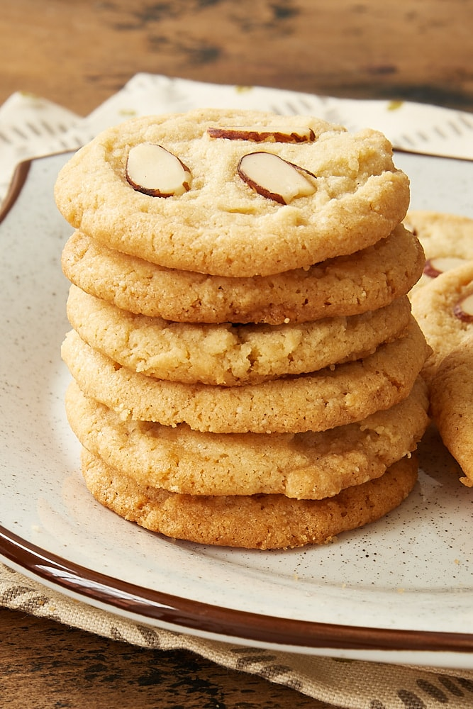 stack of Almond Cookies on a white and brown speckled plate