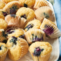 Blueberry Sour Cream Mini Muffins on a white tray