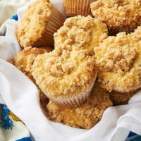 Vanilla Crumb Muffins in a towel-lined metal basket