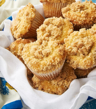 Vanilla Crumb Muffins in a towel-lined metal basket