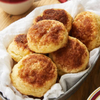 Cinnamon Sugar Biscuits in a metal basket lined with a white cloth