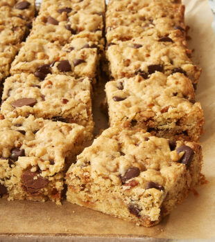 Loaded Chocolate Chip Cookie Bars on parchment paper