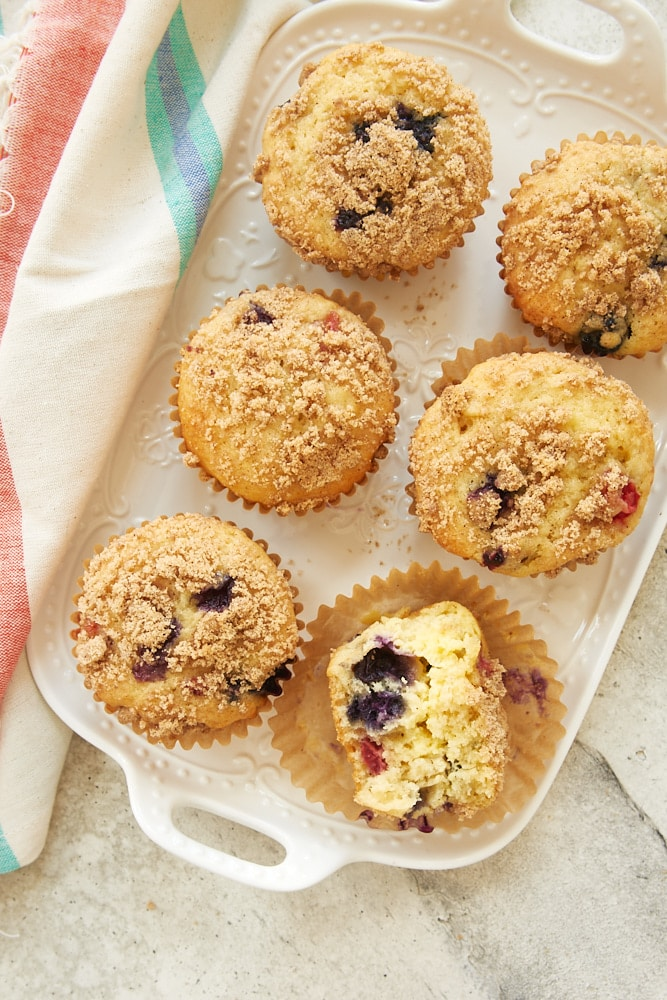 overhead view of Berry Cheesecake Muffins on a white tray