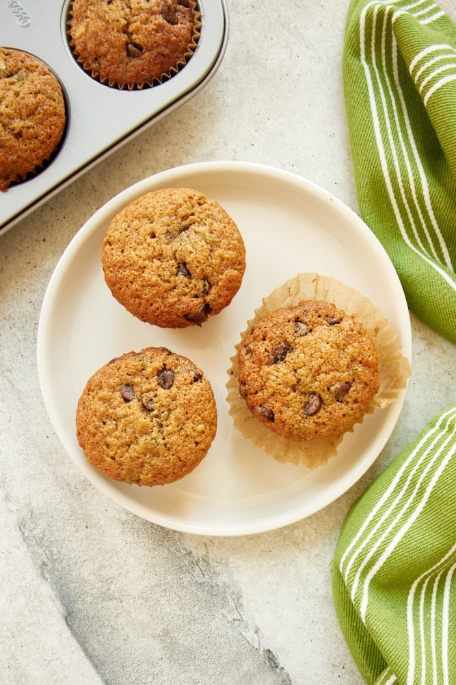 overhead view of Chocolate Chip Zucchini Muffins on a white plate