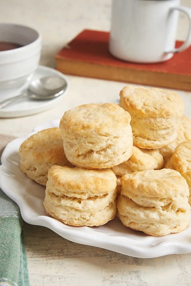 Cream Cheese Biscuits stacked on a white plate