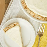 overhead view of Lemon Icebox Pie with Toasted Coconut Crust on a white plate