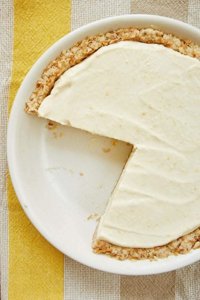 overhead view of Lemon Icebox Pie with Toasted Coconut Crust in a white pie plate