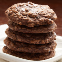 stack of Salted Chocolate Truffle Cookies on a white plate