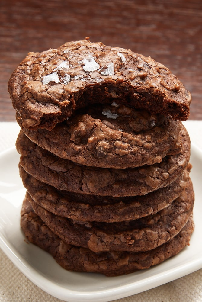 partially eaten Salted Chocolate Truffle Cookie on top of a stack of cookies