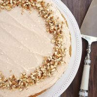 overhead view of Apple Spice Cake with Cinnamon Cream Cheese Frosting topped with chopped nuts