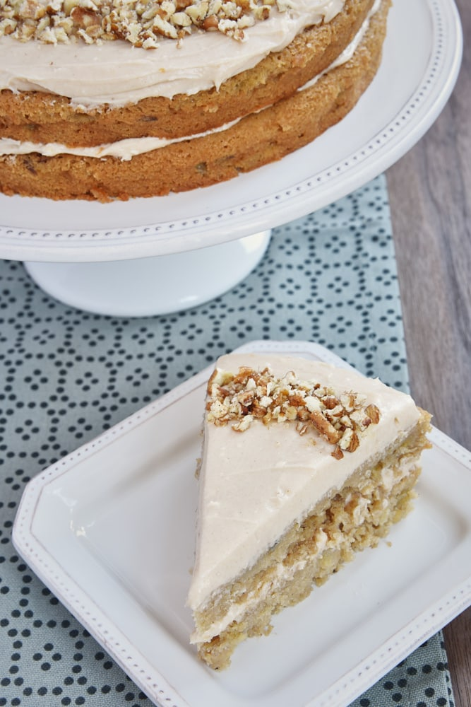 slice of Apple Spice Cake with Cinnamon Cream Cheese Frosting on a white plate