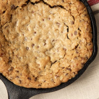 overhead view of a Mini Skillet Chocolate Chip Cookie on a striped towel