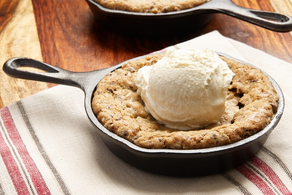 Mini Skillet Chocolate Chip Cookies topped with ice cream