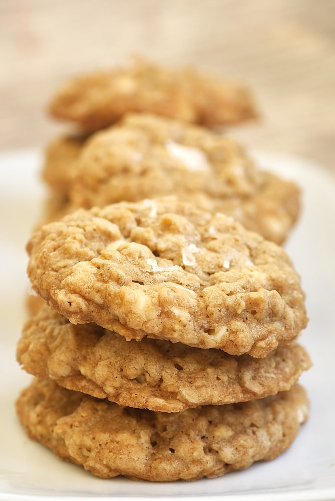 Salted Vanilla Chip Oatmeal Cookies stacked on a white plate
