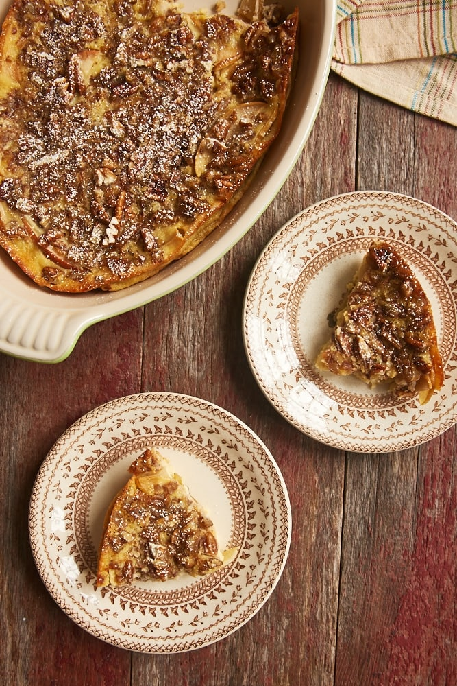 overhead view of Apple Bourbon Clafoutis served on brown-rimmed floral plates
