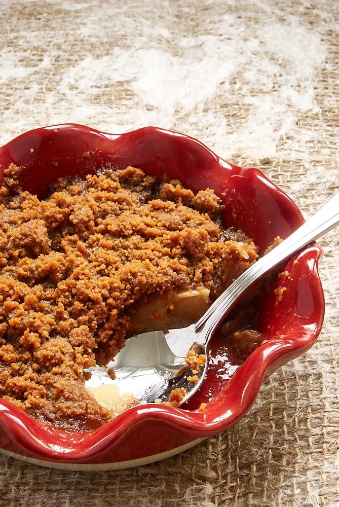 Apple Pear Biscoff Crisp with a spoonful missing