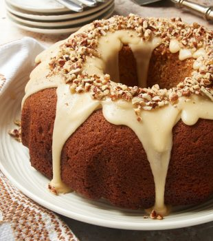 Brown Sugar Spice Cake with Caramel Rum Glaze on a white plate