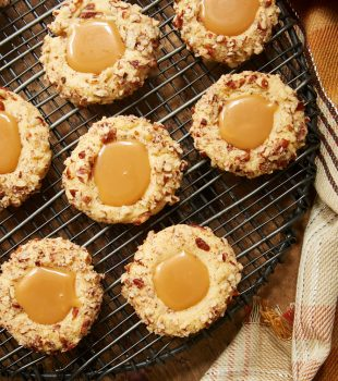 overhead view of Caramel Pecan Thumbprint Cookies on a wire rack
