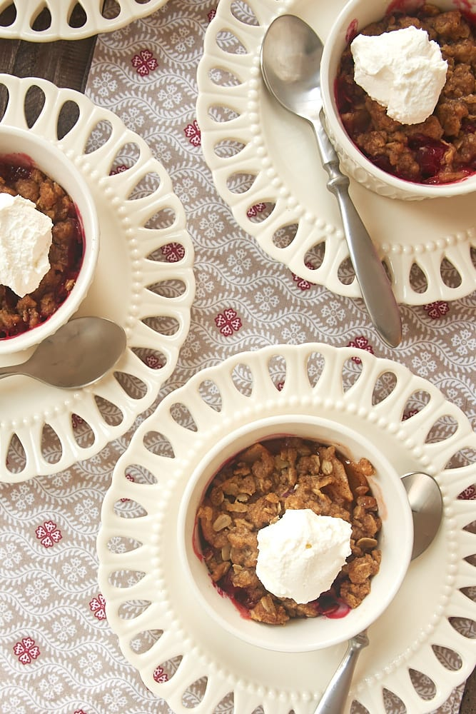 overhead view of Cranberry Pear Crumbles in white ramekins