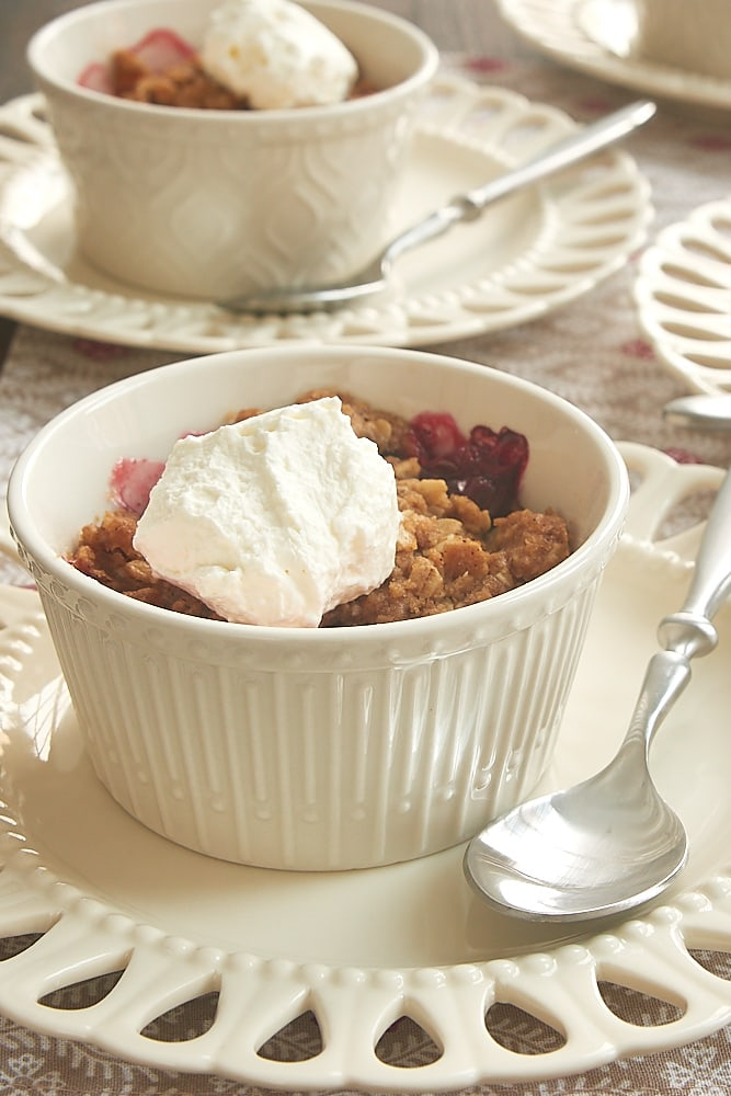 Cranberry Pear Crumbles served in white patterned ramekins