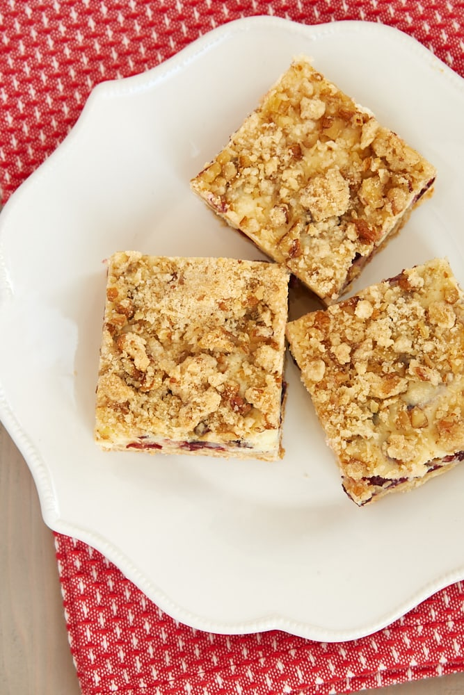 overhead view of Cranberry Crumble Cheesecake Bars on a white plate