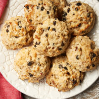 overhead view of Currant Oat Scones on a patterned white plate