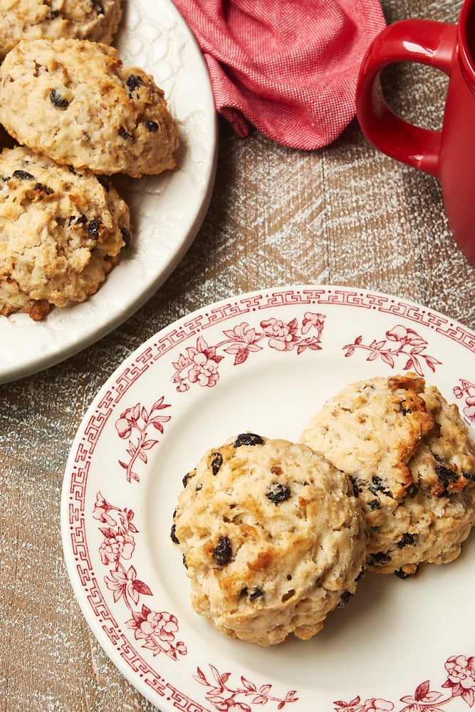 Currant Oat Scones on a red floral-rimmed white plate