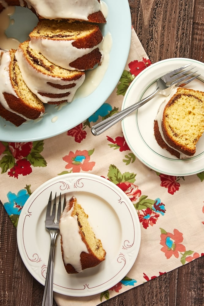 overhead view of slices of Cinnamon Breakfast Cake on color-rimmed white plates
