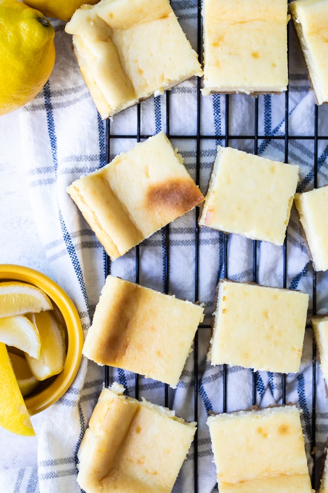 overhead view of Limoncello Cheesecake Squares on a wire rack