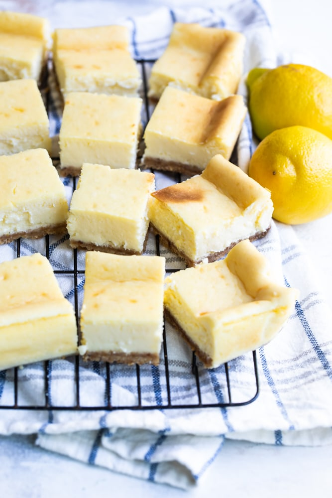 Limoncello Cheesecake Squares on a wire rack