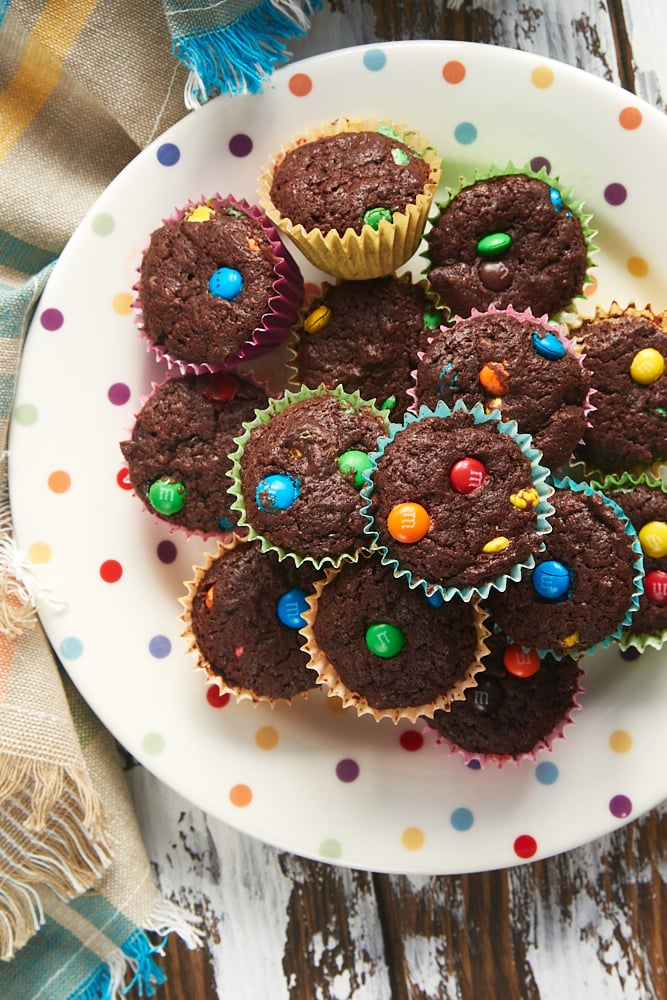 overhead view of M&M Brownie Bites on a multi-colored polka dot plate